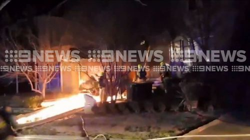 Neighbours were trapped outside for hours last night as fire crews battled the flames. Picture: 9NEWS