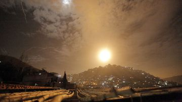 Syrian air defenses intercept Israeli missiles targeting an area in Damascus, Syria.