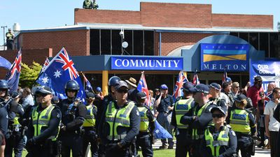 Anti-Islam protesters are surrounded by police as the members of Campaign Against Racism and Fascism hold a counter-rally nearby. (AAP)