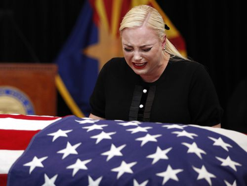 Daughter Cindy bursts into tears at the casket in Arizona.