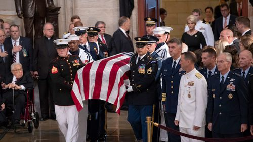 Congressional leaders have saluted John McCain today as a model of service in war and peace, in a memorial ceremony at the heart of the political battlefield where the late senator fought for more than three decades.