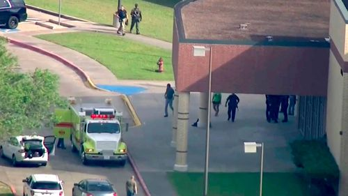 Officers respond to a Santa Fe high school near Houston, Texas, after reports of an active shooter. (AAP)
