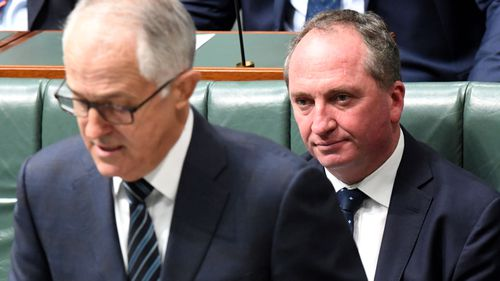 Under-pressure Barnaby Joyce sitting on the benches in Parliament behind Malcolm Turnbull today in Canberra.