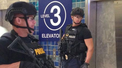 Flights were grounded at Phoenix Sky Harbor International Airport as police searched for a third shooting suspect.