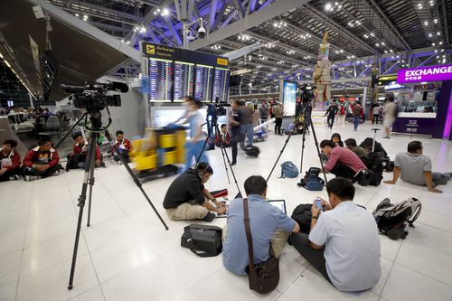 Photographers wait at Bangkok airport to catch a glimpse of Hakeem.