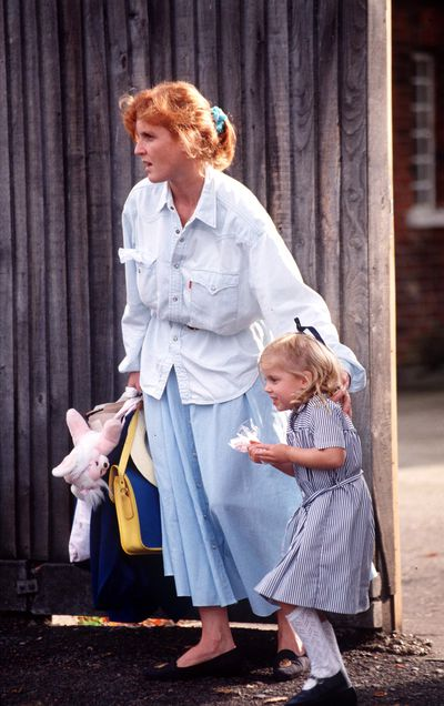 <p>A rare snap of The Duchess of York collecting daughter Princess Beatrice from Upton House School, London, wearing a nineties classic - the blue chambray shirt.</p>