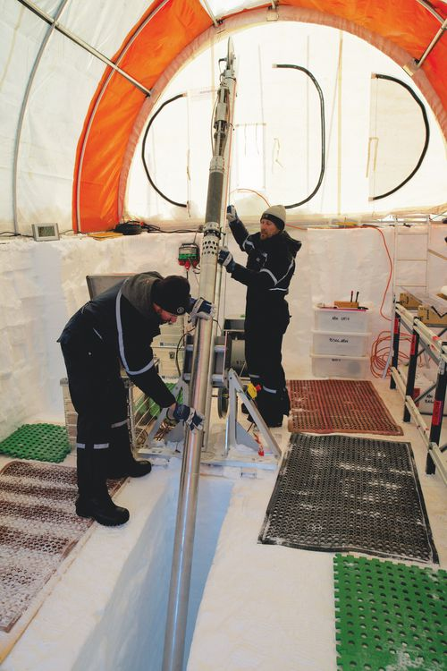 Australian scientists set up the ice drill in preparation of retrieving samples from under the ice cap.