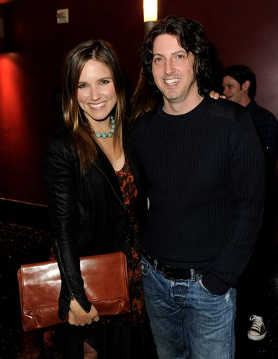Sophia Bush and Mark Schwahn pose at a CW event in 2011