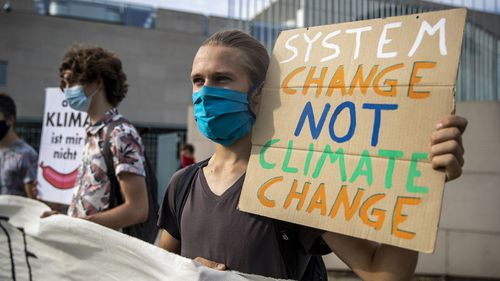 Climate activists demonstrate in front of the German Chancellery on August 20, 2020 in Berlin, Germany