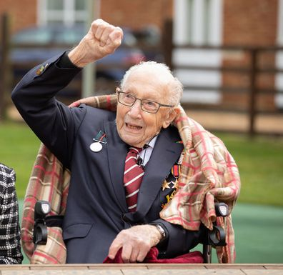 Colonel Tom Moore and his daughter Hannah celebrate his 100th birthday, with an RAF flypast provided by a Spitfire and a Hurricane over his home on April 30, 2020 in Marston Moretaine, England