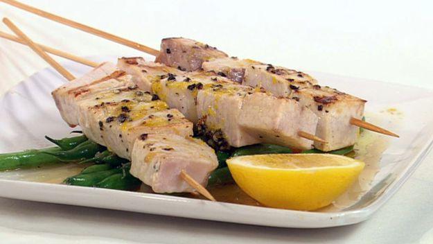 Lemon and pepper swordfish skewers with garlic green beans