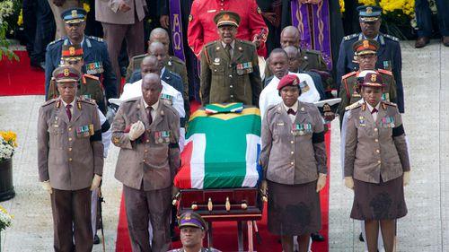 A military honour guard carries anti-apartheid activist Winnie Madikizela-Mandela's coffin. (AP)