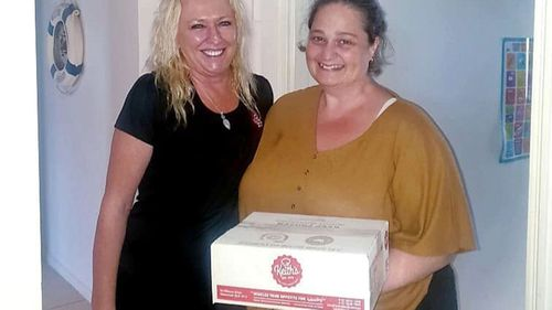 Karen Alisia from Keith's Quality Foods, picutured with Leanne Page after dropping off a box of the dagwood dogs.