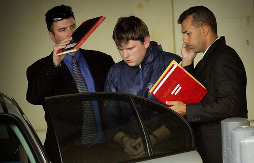 Dante Arthurs being led from Cannington Police station after being charged in June 2006. Picture: AAP