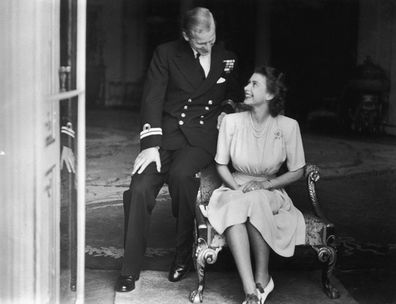 Princess Elizabeth (later Queen Elizabeth II) and her fiance, Philip Mountbatten at Buckingham Palace, after their engagement was announced, 10th July 1947.