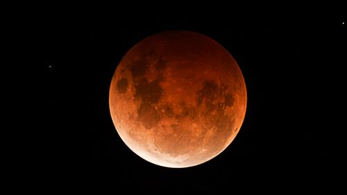 Professional photographer Stephen Scheer captured this photo of a blood moon earlier this year from Woodcroft in South Australia.