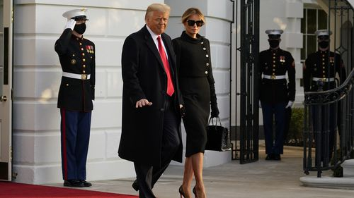 President Donald Trump and first lady Melania Trump depart the White House to board Marine One, Wednesday, Jan. 20, 2021, (AP Photo/Alex Brandon)