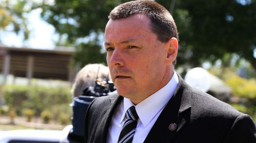 Detective Inspector Damien Hansen allegedly asked for police criticisms to be removed from an investigator's report for the ongoing Whiskey Au Go Go inquest.