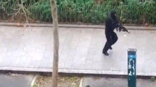 The gunmen were filmed running across the street outside the magazine office.