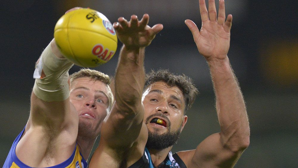 Port Adelaide's Patrick Ryder takes on a West Coast opponent. (AAP)
