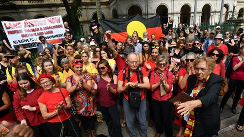 Wangan and Jagalingou traditional owners and their supporters are seen protesting outside Parliament House in Brisbane in March 2018. Picture: AAP