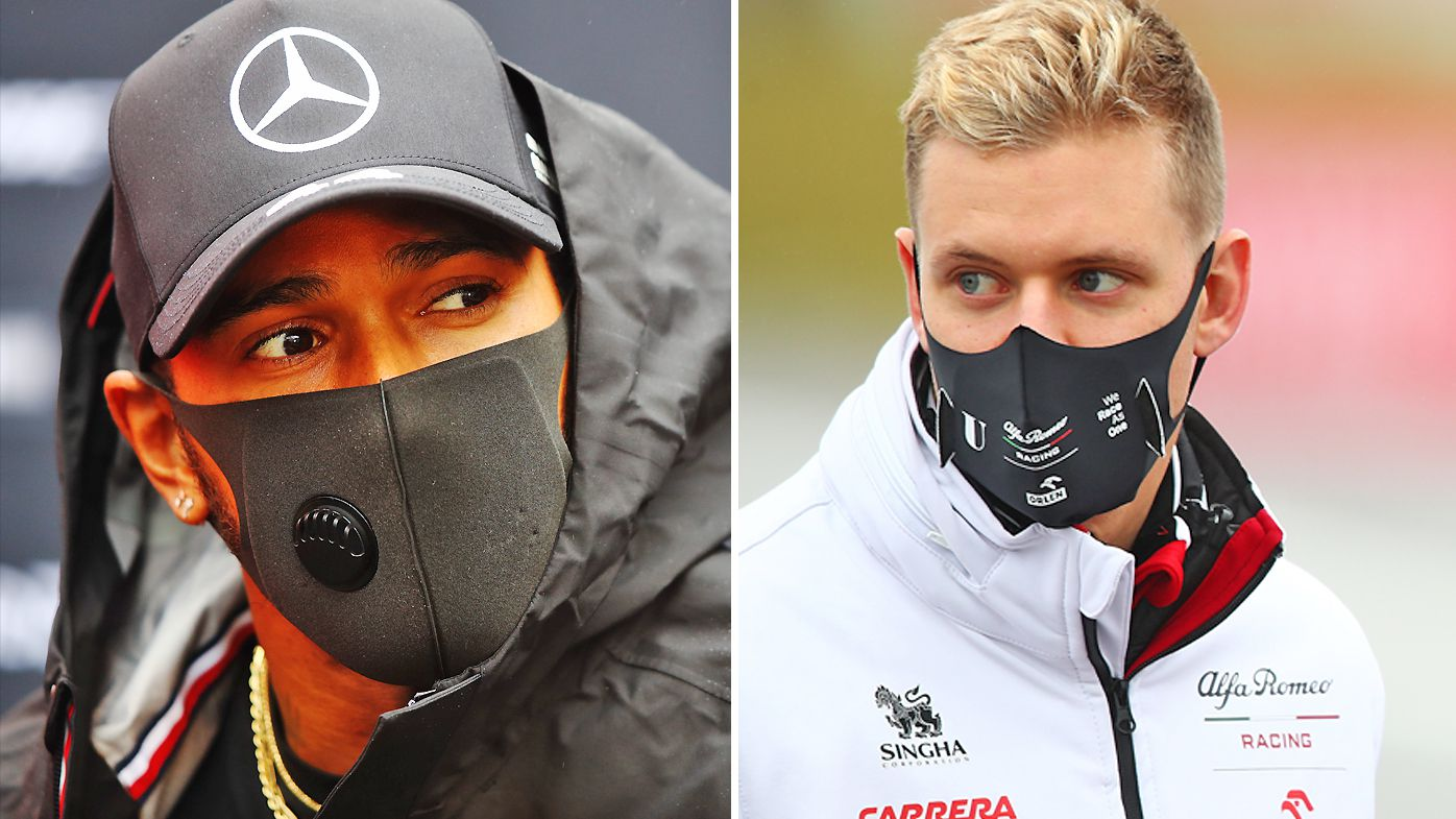 Lewis Hamilton of Great Britain and Mercedes and Mick Schumacher of Germany and Alfa Romeo Racing