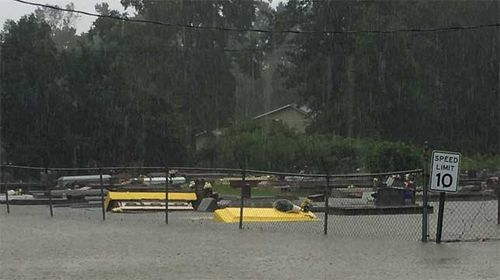 Coffins rise from the grave during intense US floods (Gallery)
