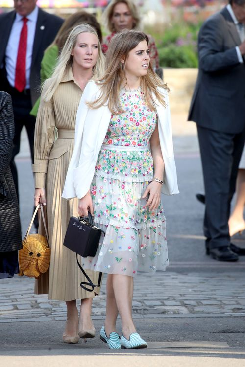Princess Beatrice mixes a floral dress with a white jacket for the opening day of the show (AAP)