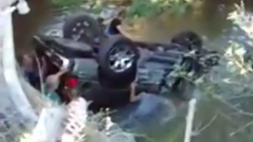 Three teen boys had to be rescued after their car crashed into a river in the US. (YouTube)
