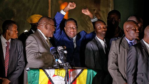 Zimbabwe's president in waiting Emmerson Mnangagwa, greets supporters gathered outside the Zanu-PF party headquarters in Harare. (Photo: AP).