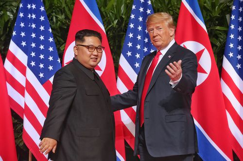Mr Trump and Kim shared some brief words as they spoke to each other in that first encounter. Picture: AAP