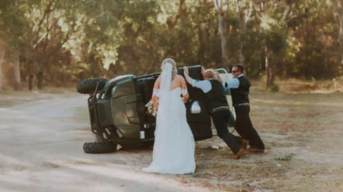 The couple soon jumped to help get their groomsman back on his feet. (RNC Photography via Facebook)