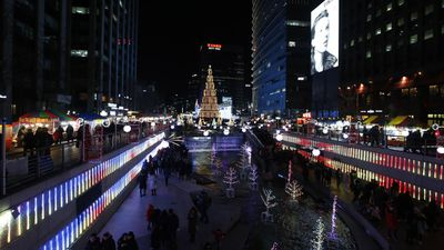 People walk among illuminated decorations at Cheonggye street during New Year's Eve celebrations in Seoul, South Korea.