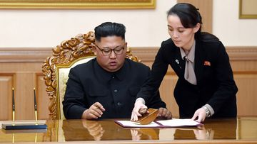 In this Sept. 19, 2018, file photo, Kim Yo Jong, right, helps her brother North Korean leader Kim Jong Un sign a joint statement following the summit with South Korean President Moon Jae-in at the Paekhwawon State Guesthouse in Pyongyang, North Korea.