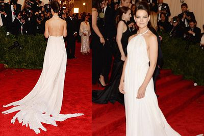 Katie Holmes looks beautiful in a white Calvin Klein dress on arrival for the MET Gala in NYC.