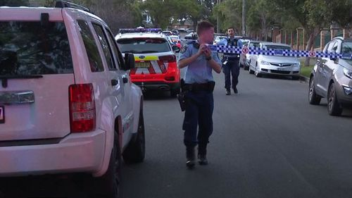 Police on the scene of a stabbing in Oatlands, in north-west Sydney.