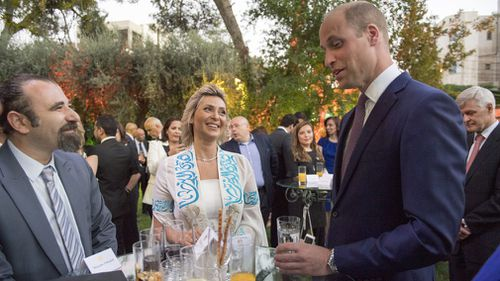 The Duke of Cambridge speaks to Alia Twal, the first woman pilot on Royal Jordanian Airways, as he attends the Queen's Birthday Party at UK Ambassador's residence in Amman, Jordan at the start of his Middle East tour,. Picture