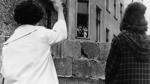 Two mothers can only wave to their children and grandchildren in the Soviet sector of Berlin from across the Berlin wall. (Photo by Keystone/Getty Images)