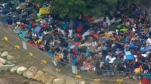 Revellers have been lining up since yesterday to ensure they secure a prime spot. (9NEWS)