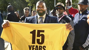 Juwan Deering holds a t-shirt from the National Organization of Exonerees that displays the amount of time her served in prison after he was released from custody.
