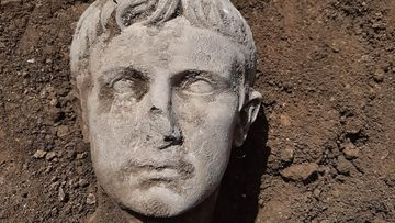 Ancient Roman Emperor's head emerges from the dirt