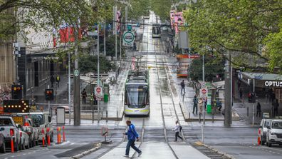 A general view of trams and pedestrians at Bourke Street Mall in Melbourne.