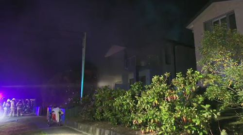 Emergency services were called to the Putney home as thick smoke billowed from the property, but were faced with barbed wire and hoarded items. Picture: 9NEWS.