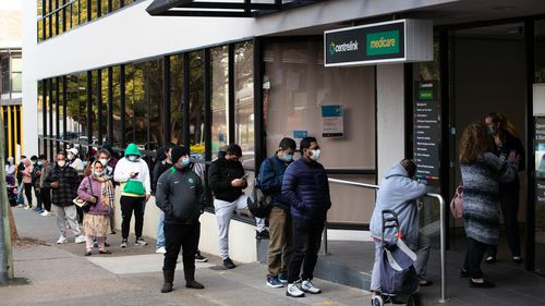 The queue for Centrelink in Campsie stretches down the street, during Sydney's lockdown.