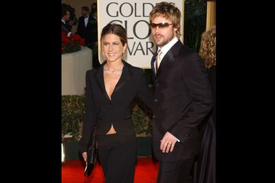 Umm… not sure what's going on with Brad here, but Jen is smoking in her black suit with nothing underneath!