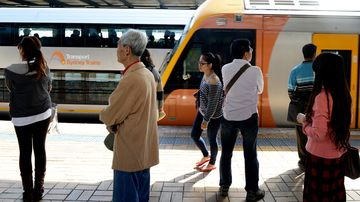 Commuters wait at Central Railway Station in Sydney. (AAP)