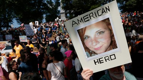 Counter-protesters paid tribute to Heather Heyer, the woman killed at the Virginia rally. (AP)
