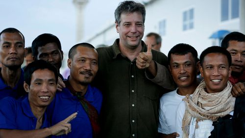 Michael Scott Moore in 2016 with released hostages who were kidnapped from ships by Somali pirates.