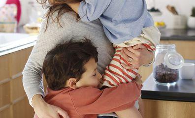 Woman hugging children