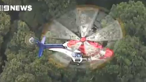 The rescue helicopter at the scene. (9NEWS)